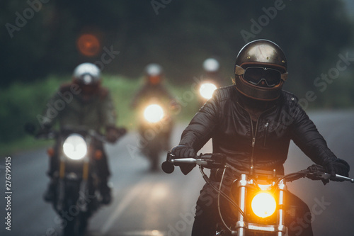 A group of motorcyclists are traveling on the rainy highway. Fototapeta