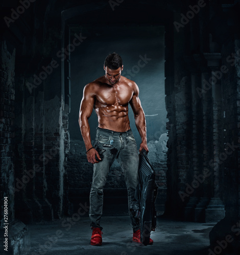 Handsome Athletic Male Fashion Model in Leather Jacket and Jeans Wall mural