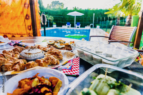 Fotografia, Obraz  A copious snack served by the pool during the summer holidays.