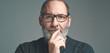 Leinwandbild Motiv Portrait of a bearded mature adult casual Businessman with glasses looking into camera