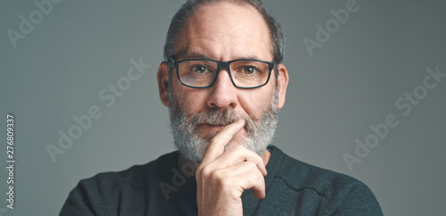 Montage in der Fensternische Logo Portrait of a bearded mature adult casual Businessman with glasses looking into camera
