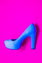 Blue High Heeled Shoes On Pink...
