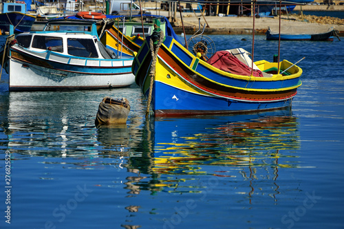 Poster Channel close up colorful traditional wooden fishing boats in harbor of Mediterranean island Malta