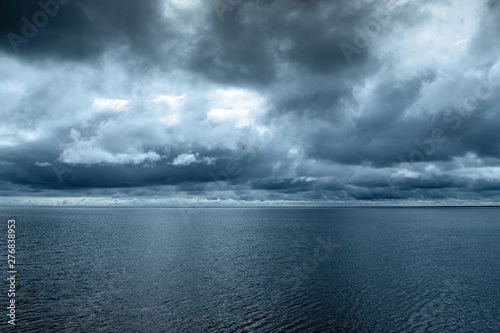 Fotografia  Clouds over gulf of Riga, Baltic sea.