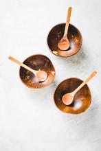 Three Empty Coconut Bowl With Spoon
