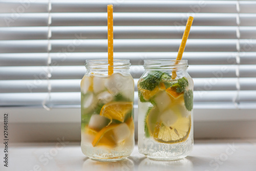 In de dag Voorgerecht non-alcoholic summer drink with lemon, orange ice, on a light background, high key