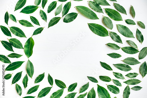 Green Leaves On White Background Healthy Lifestyle Photo