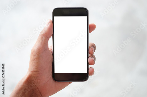 Foto  Cropped shot view of man hands holding smart phone with blank copy space screen for your text message or information content, female reading text message on cell telephone during in urban setting