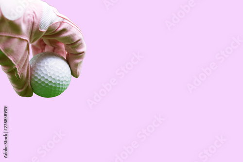 Valokuva  golf ball isolated on pink background