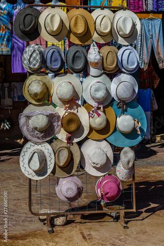 Spoed Foto op Canvas Marokko Different hats for sale in a street shop