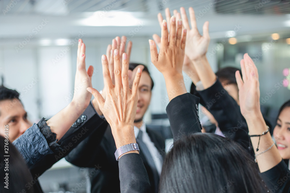 Fototapety, obrazy:  Happy Business people showing team work and giving five after signing agreement or contract with foreign partners in office interior.