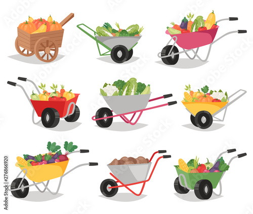 Foto Vegetables in wheelbarrow healthy nutrition of vegetably tomato pepper and carro