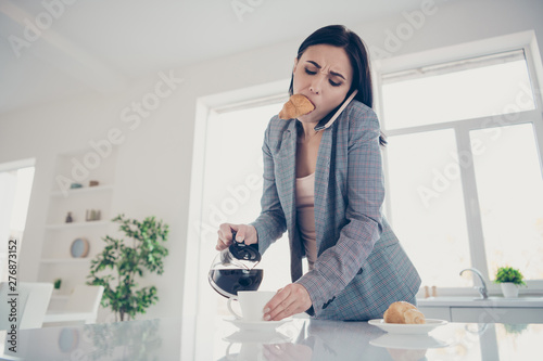 Valokuvatapetti Close up photo beautiful tired she her lady pour cup hot beverage croissant insi