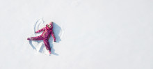 Kid Making A Snowangel. View From Above