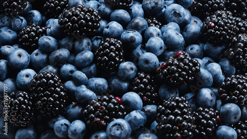 Fényképezés  Blackberry and  blueberry background. Top view.