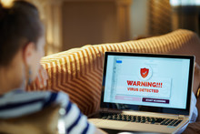 Sad Modern Woman Having Virus On Laptop