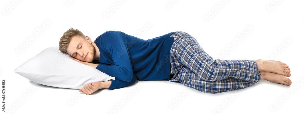 Fototapeta Handsome sleeping man with pillow on white background