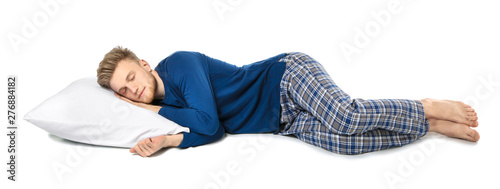 Obraz Handsome sleeping man with pillow on white background - fototapety do salonu