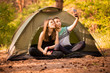 Camping couple in tent taking selfie. Happy friends having fun togheter. Concept people, lifestyle and technology
