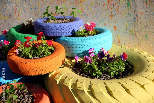 Slika na platnu flowerbed of car tires