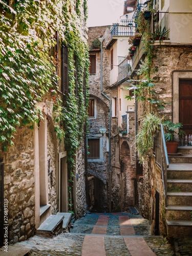 Fototapeten Schmale Gasse Medieval streets of the Italian city of Dolceacqua in Liguria