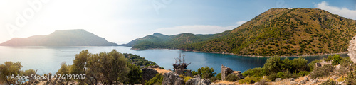 Fotografie, Obraz Pirate ship moored in a secluded bay with turquoise water at sunset, Oludeniz, T