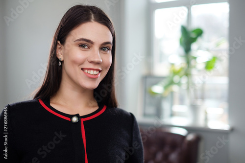 Portrait of a smiling brunette girl