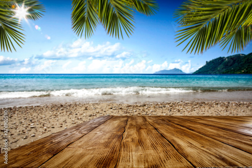 Desk of free space and summer beach background