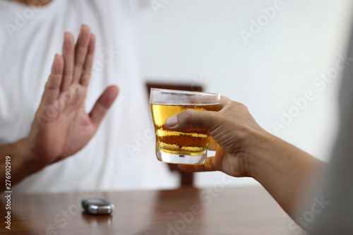 Do not drink and drive concept, Man hand holding glasses of beer and Man showing Fototapet