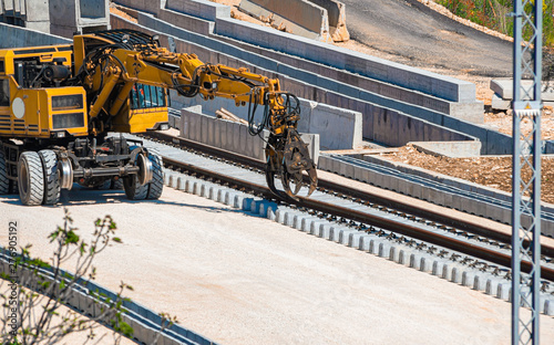 Fotografia Close up rail excavator on reconstruction of the railway rails