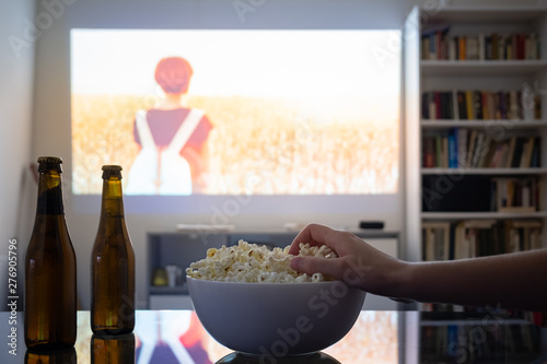 Home cinema entertainment: watching a film from a video projector in a room Canvas Print
