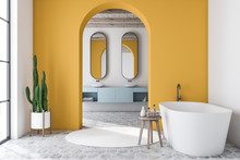 Yellow Arched Bathroom Interior, Tub And Sink