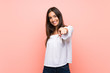 canvas print picture - Young woman over isolated pink background points finger at you with a confident expression