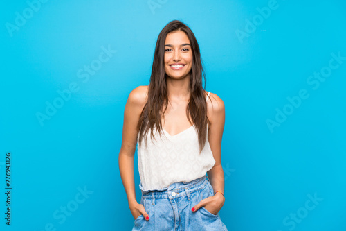 Carta da parati  Young woman over isolated blue background laughing