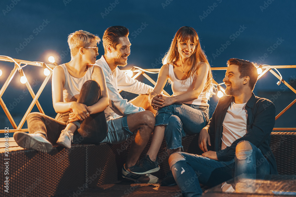 Fototapety, obrazy: Group of friends enjoying outdoors at roof