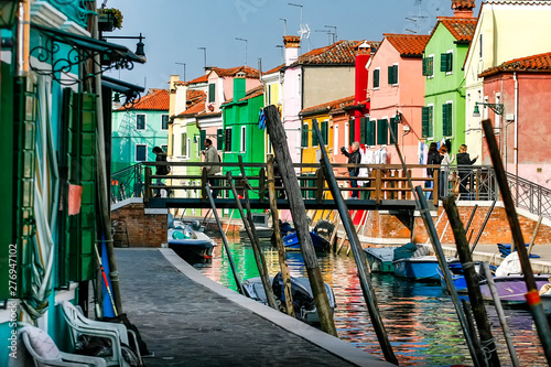 Street with colorful buildings in Burano island, Venice, Italy.  April 2012