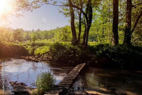 Montage in der Fensternische Wasserfalle bridge over the river in the forest