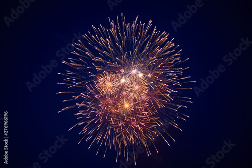 Cheap beautiful large fireworks, white-yellow, in the night sky, background texture - 276966196