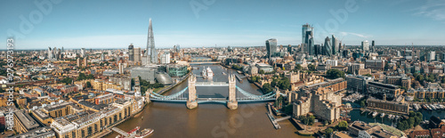 Tower Bridge in London, the UK. Bright day over London. Drawbridge opening. One of English iconic symbols. - 276973193