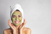 Young Woman With Clay Mask On Her Face Against Light Background, Space For Text. Skin Care