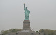 Statue of Liberty (American Flag to the right) on an Overcast Spring Morning