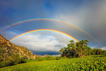 Double rainbow in the Wasatch Mountains, Utah, USA.