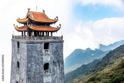 Leinwand Poster  The Stone Pagoda and pavilion in Temple on Fansipan mountain peak the highest mountain in Indochina