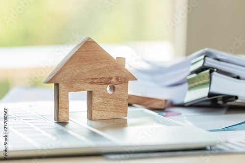 Fototapeta Model home on laptop with chart report documents contact customer paperwork for loan real estate and buy new for family or mortgage investment  obraz