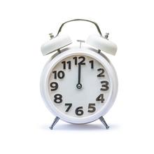 White Alarm Clock At 12.00 Twe...