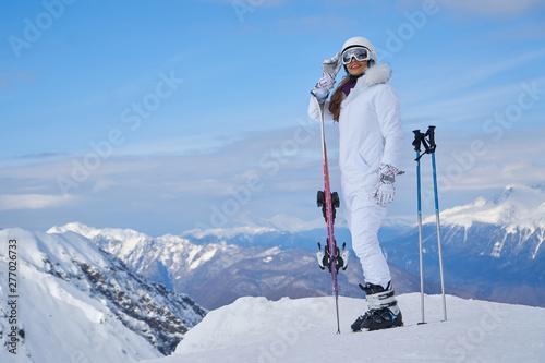 Young caucasian woman skier Fototapeta