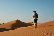 Young Tourist In Desert