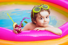 Summer Holidays And Vacation Concept. Children Playing And Active Leisure - Swimming Pool Concept. Children Playing In Pool. Kids Happy. Beach Party. Caribbean Sea In Bahamas.