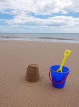 Child's Bucket And Spade With Sandcastle, Bridlington Beach