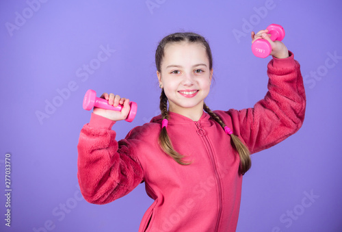 Rehabilitation concept  Girl exercising with dumbbell  Child hold
